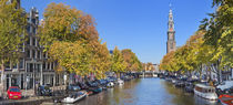 Canal and Westerkerk tower in Amsterdam, The Netherlands in autumn