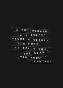 A Photograph Is A Secret Embossed Labels Black by Brian Carson