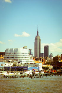 NYC Empire State building with Frank Gehry's IAC Building  by Perry  van Munster