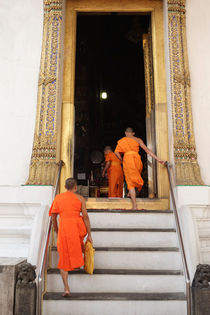 Monks arriving at Wat Suthat Thep Wararam, Buddhist Temple Bangkok Thailand  by Perry  van Munster