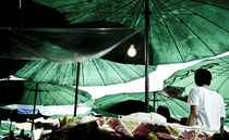 Green Parasols at a Thai street food  by Perry  van Munster