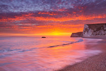 Cliffs at Durdle Door beach in Southern England at sunset by Sara Winter