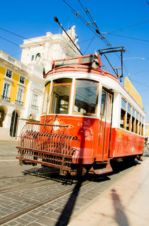 Old tram at palace square or Commerce Square, Lisbon, Portugal. by Perry  van Munster