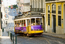 Line 28, old tram in the streets of Lisbon, Portugal. by Perry  van Munster