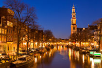 The Western Church and a canal in Amsterdam at night by Sara Winter