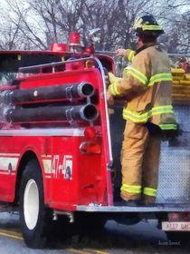 Fireman on Back of Fire Truck von Susan Savad