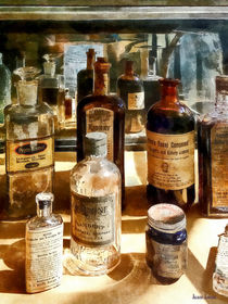 Medicine Bottles in Glass Case von Susan Savad