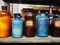 Orange, Brown and Blue Bottles of Chemicals von Susan Savad
