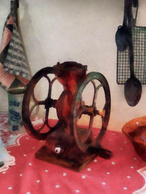 Coffee Grinder on Red Tablecloth by Susan Savad
