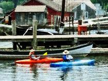 Orange and Blue Kayaks by Susan Savad