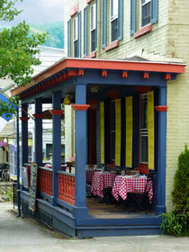 Outdoor Cafe with Checkered Tablecloths by Susan Savad