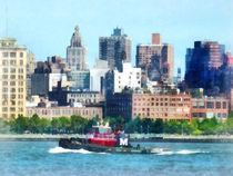 Manhattan NY - Tugboat Against Manhattan Skyline by Susan Savad