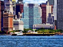 Tugboat Pushing Barge Near Manhattan Skyline by Susan Savad