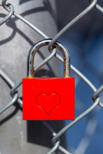 Red heart lock on fence by wsfflake