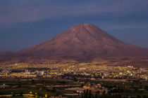 Single volcano on the background of the city at night.  by Aleksei Diachkov