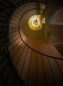 Spiral staircase in brown and yellow tones by Jarek Blaminsky