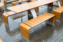 Wet outdoor cafe tables on the street after a rain by Vladislav Romensky