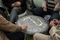 Group of men playing domino on free time by Masoud Rezaeipoor