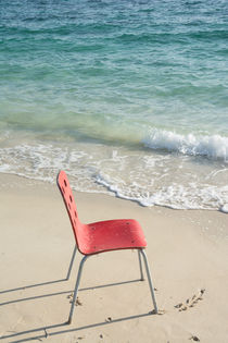 Single Red Chair at Beach by Masoud Rezaeipoor