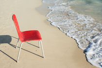 An Empty Single Red Chair at Beach by Masoud Rezaeipoor