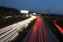 Car Light Traces From Moving On Highway At Dusk by Masoud Rezaeipoor