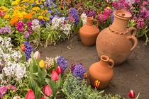 Water Container Earthenware Jugs Inside Flower Bed in Outdoor by Masoud Rezaeipoor