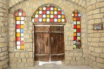 Old Wooden Door With Colorful Glasses von Masoud Rezaeipoor