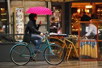 Cycling on a Rainy Day in Milan by Carlos Alkmin