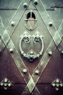 Ornamented metal gates with nice doorknob by Jarek Blaminsky