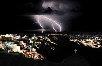 Lightning during a Thunderstorm on the island of Santorini, Greece by Yuri Hope