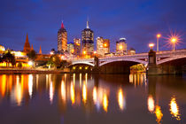 Skyline of Melbourne, Australia across the Yarra River at night by Sara Winter