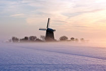 Traditional windmill in snowy landscape in the Netherlands by nilaya
