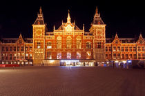 Medieval central station in Amsterdam Netherlands by night by nilaya