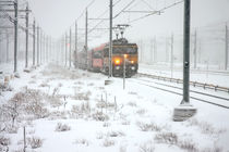 Train driving in heavy snow in the Netherlands by nilaya