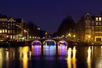 Amsterdam at the Amstel by night in the Netherlands by nilaya