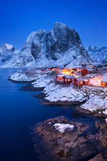 Norwegian fisherman's cabins on the Lofoten at dawn in winter by Sara Winter
