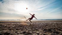 Football on the beach   by Abe  Raats