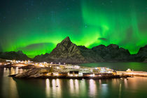 Aurora borealis over a village on the Lofoten in Norway by Sara Winter
