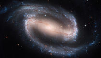 Barred Spiral Galaxy NGC 1300. by Stocktrek Images