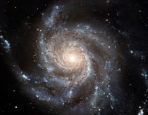 Spiral galaxy Messier 101. by Stocktrek Images
