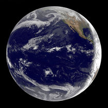 Earth centered over the Pacific Ocean. by Stocktrek Images
