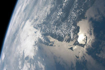 Sunglint on the waters of Earth. von Stocktrek Images
