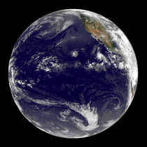 Earth showing tropical cyclones in the Pacific. by Stocktrek Images