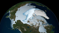 Planet Earth showing sea ice coverage in 2012. by Stocktrek Images