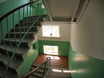 Staircase between floors in high-rise building by Vladislav Romensky