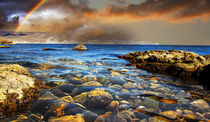 Coastal pebbles in the clear water by Yuri Hope