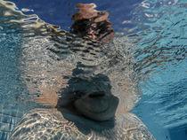 Man in the water by Xavier Minguella