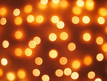 Abstract defocused and blur bokeh of small yellow lights by Vladislav Romensky