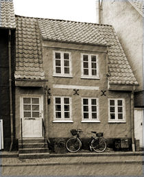A Danish house and bicycle. by Philip Shone