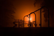 Playground in fogg in autumn by Alexander Trattler